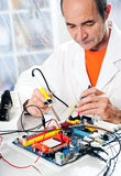 Senior tech tests electronic equipment Royalty Free Stock Photo