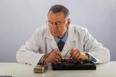 Senior Technician Fixing Laptop Stock Photos