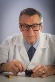 Senior Technician with Glasses Stock Photo