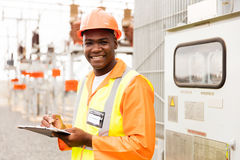 Senior technician holding clipboard. In substation Royalty Free Stock Photo