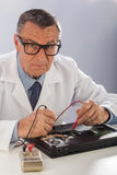 Senior Technician with Multimeter Royalty Free Stock Images