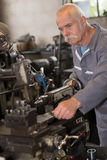 Senior technician repairing and checking engine stock photography