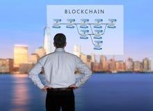 Senior technologist looking at blockchain illustration Royalty Free Stock Photo
