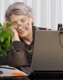 Senior teleworker is falling asleep Royalty Free Stock Photography