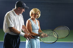 Senior Tennis Instruction. Senior Health and Fitness Tennis instruction at wellness center royalty free stock images