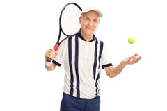 Senior tennis layer holding a racket. And throwing the ball isolated on white background Stock Images