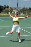 Senior tennis player. An active senior woman having fun during a game of tennis royalty free stock photos
