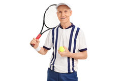 Senior tennis player holding racquet and a ball. Studio shot of a senior tennis player holding a racquet and a ball isolated on white background Stock Photography