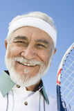 Senior Tennis Player Holding Tennis Racquet Stock Photo