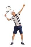 Senior tennis player preparing to serve Royalty Free Stock Images