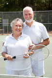 Senior Tennis Players. Active senior couple on the tennis courts Stock Images