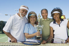 Senior Tennis Players Holding Trophy Stock Photography