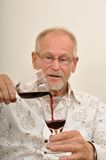 Senior testing wine Royalty Free Stock Photos