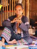 Senior Thai man performing music Royalty Free Stock Photography