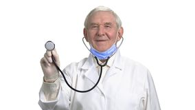 Senior therapist checking your health. Smiling old doctor with stethoscope on white isolated background stock footage