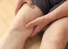 Senior with thigh muscle pain Stock Photos