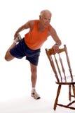 Senior Thigh Stretch Stock Photography