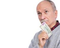 Senior thoughtful man holding dollar bill Royalty Free Stock Photography