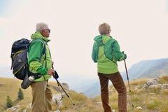 Senior tourist couple hiking at the beautiful mountains royalty free stock photo