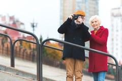 senior tourist couple taking photo royalty free stock photo