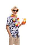 Senior tourist holding a cocktail Stock Image