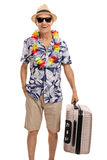 Senior tourist holding a suitcase Stock Photography