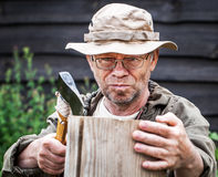 Senior tourist man with axe Royalty Free Stock Photography