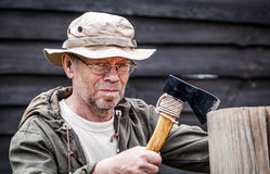 Senior tourist man with axe Stock Image