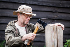 Senior tourist man with axe Royalty Free Stock Photo