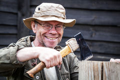 Senior tourist man with axe Stock Photo