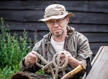 Senior tourist man with axe Royalty Free Stock Image
