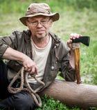Senior tourist man with axe Stock Photos