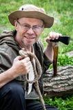 Senior tourist man with axe Stock Image