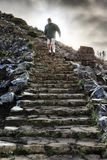 Ominous staircase Madeira. Senior tourist in the mountains of Madeira at Pico do Areeiro Arieiro, while hiking to Pico Ruivo on a cloudy summer day royalty free stock photography