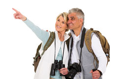 Senior tourist pointing. Happy senior tourist pointing empty space on white background Royalty Free Stock Images