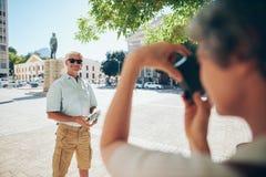 Senior tourist posing for photograph Royalty Free Stock Photography