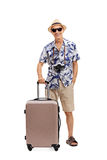 Senior tourist posing with a suitcase Royalty Free Stock Photos