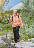 Senior tourist woman hiking. Royalty Free Stock Photo