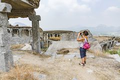 Senior tourist woman making pictures of landmark attractions. Gingee, Tamil Nadu, India Stock Photography