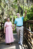 Senior Tourists. Senior couple on vacation in Florida walking through a tropical park Royalty Free Stock Photos