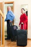 Senior tourists with luggage Stock Image
