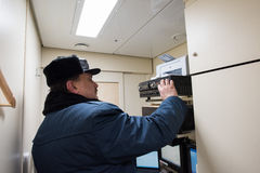 Senior train conductor in the control room Royalty Free Stock Image
