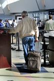Senior Traveler. An older male gets his boarding pass checked before going through the security check point Stock Images