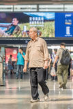 Senior traveler at Beijing Railway Station South, China Royalty Free Stock Images