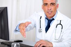 Senior trustworthy doctor greeting Royalty Free Stock Images