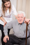 Senior trying to get up. Elder men trying to get up with walking stick assurance royalty free stock image
