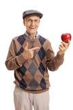 Senior trzyma wskazywać i jabłka Obrazy Stock