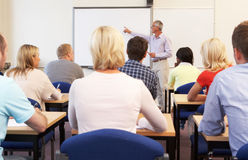 Senior tutor teaching class Stock Photo