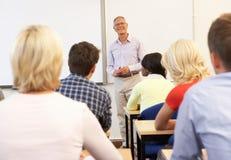 Senior tutor teaching class stock images