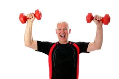 Senior with two barbells. Crazy Senior with two red barbells up Royalty Free Stock Photo
